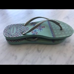 Havaianas Shoes - Havaianas slim teal/silver flip flop with elephant